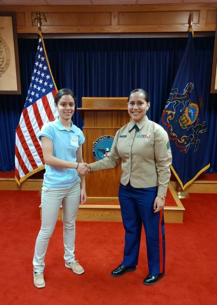 Alejandra Rivera Martinez signs with the Navy. Photo courtesy of Collin Sullivan.