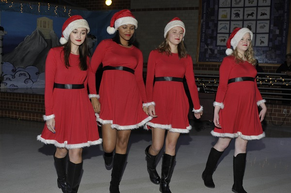 Seniors Berri Wilmore, Elle Brunner, Micah Thomas, and Gracie McGreevy perform a scene from Mean Girls.