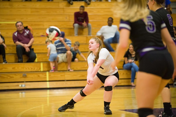 Grace Kelly digging up the volleyball to the setter. Photo courtesy of Lifetouch.
