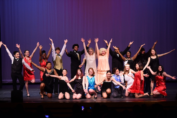 The cast poses at the end of a performance.