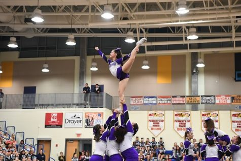 Long Reach cheerleaders support their teammate for a stunt. Photo courtesy of Lifetouch.