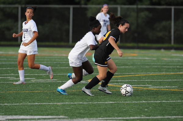 Senior Lydia Awebwa in her natural element playing soccer. Photo courtesy of Lifetouch.