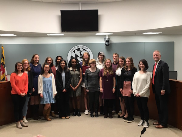 High School journalism representatives from HCPSS and Dr. Martirano smile for a picture.