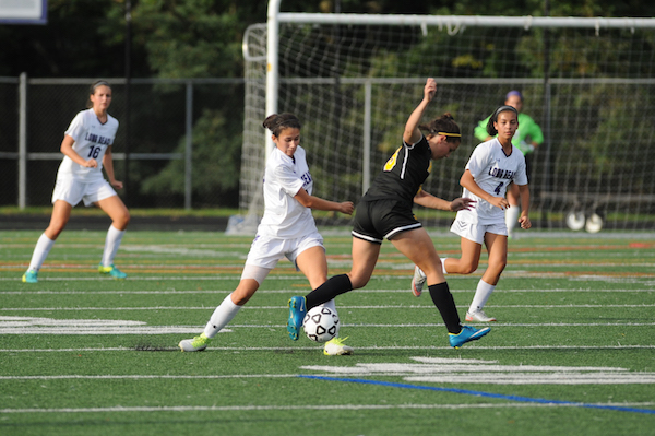 Junior Gabriela Cabrera intercepts the ball from an opponent. Photo courtesy of Lifetouch.