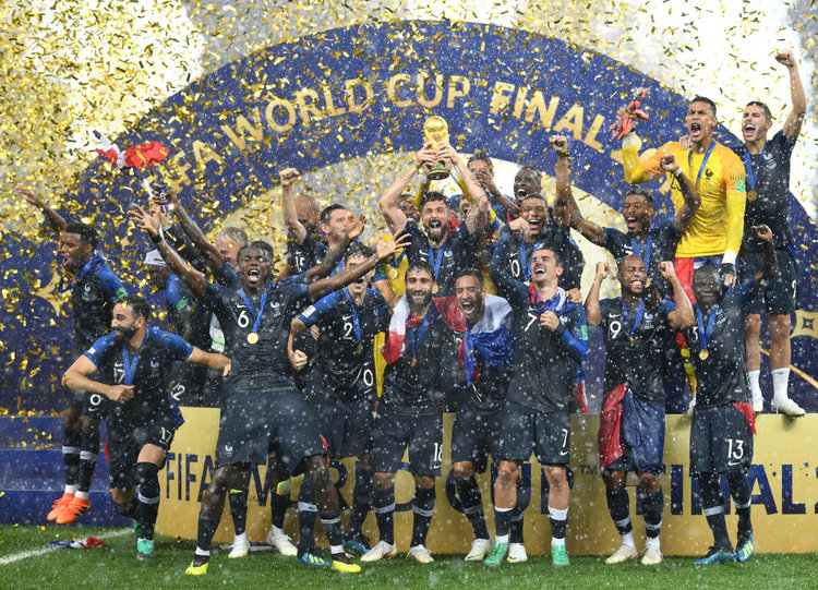 The+French+2018+World+Cup+squad+celebrating+their+4-2+win+against+Croatia.