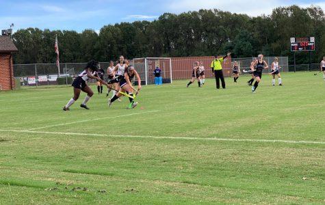 Senior Rebecca Tu drives the ball forward as her adversary tries to steal it.  Photo courtesy of Franklin Almendarez.
