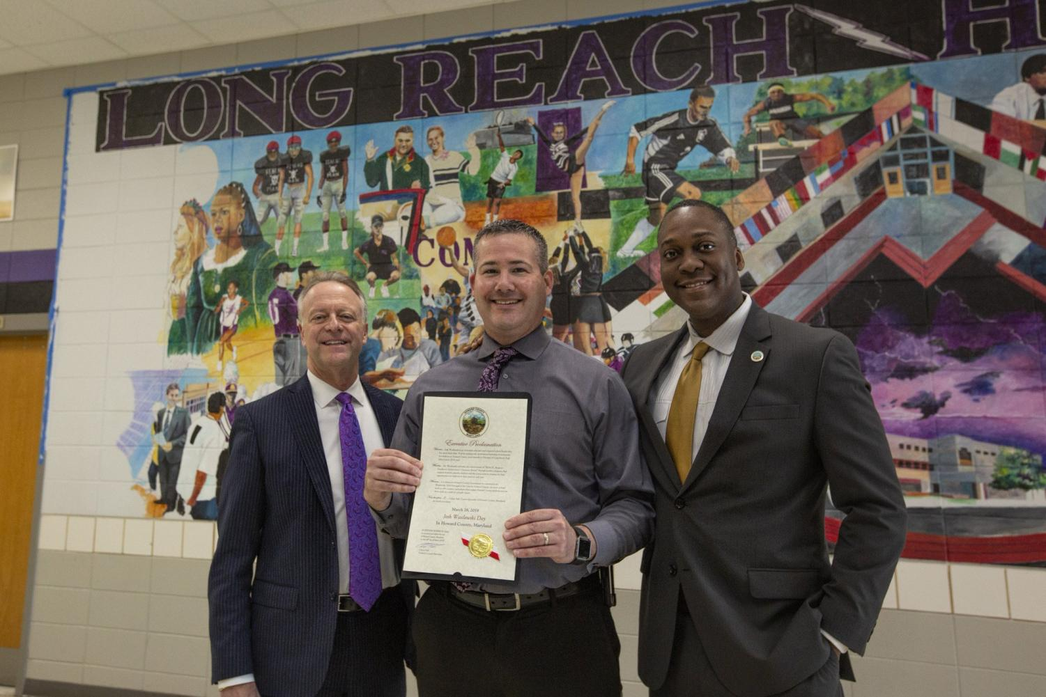 Principal Wasilewski (center) being presented with the award by Superintendent Martirano (left) and County Executive Calvin Ball (right). Photo courtesy of Long Reach High School.