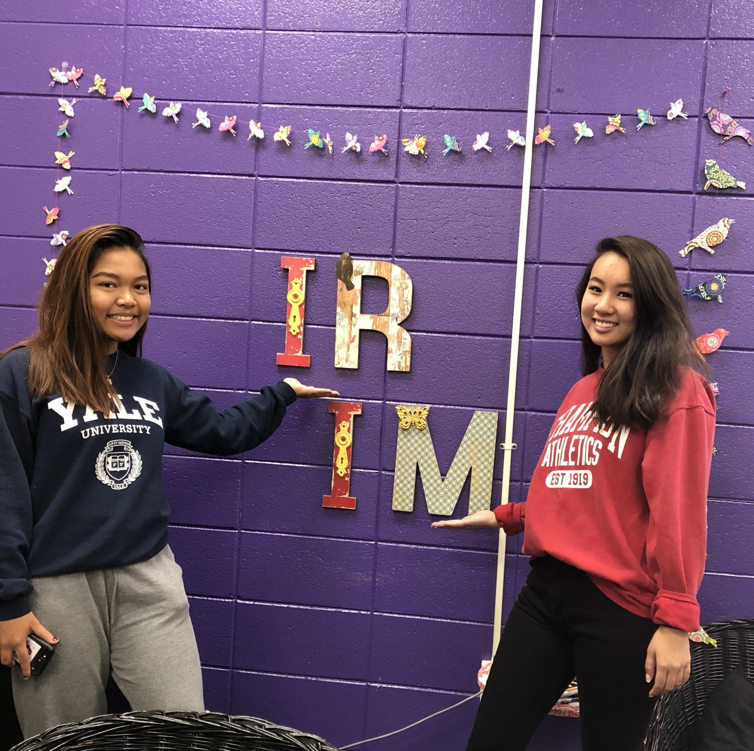 Seniors Audrey Hafizian and Sarah Ngo pose in front of the Independent Research and Intern/Mentor sign in Ms. Dungey's class. Photo Courtesy of Vung Bawi.