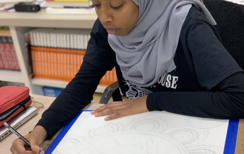 Visual/spatial learner Iman Ahmed completes a self-portrait for her Art II GT class. Photo courtesy of Tori Ely.