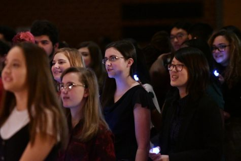 New NHS inductees stand with their lighted candles and recite the pledge. Photo courtesy of LifeTouch.