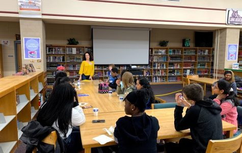 Author Heather Cumiskey with Long Reach High School students in the media center after school. Photo courtesy of Ms. Lee.