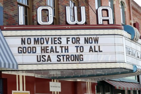 "APNews.com ""In shutdown, a glimpse of life without movie theaters."" The marquee for the Iowa Theater, closed in response to the coronavirus outbreak, is seen on John Wayne Drive, Wednesday, April 1, 2020, in Winterset, Iowa. (AP Photo/Charlie Neibergall)"